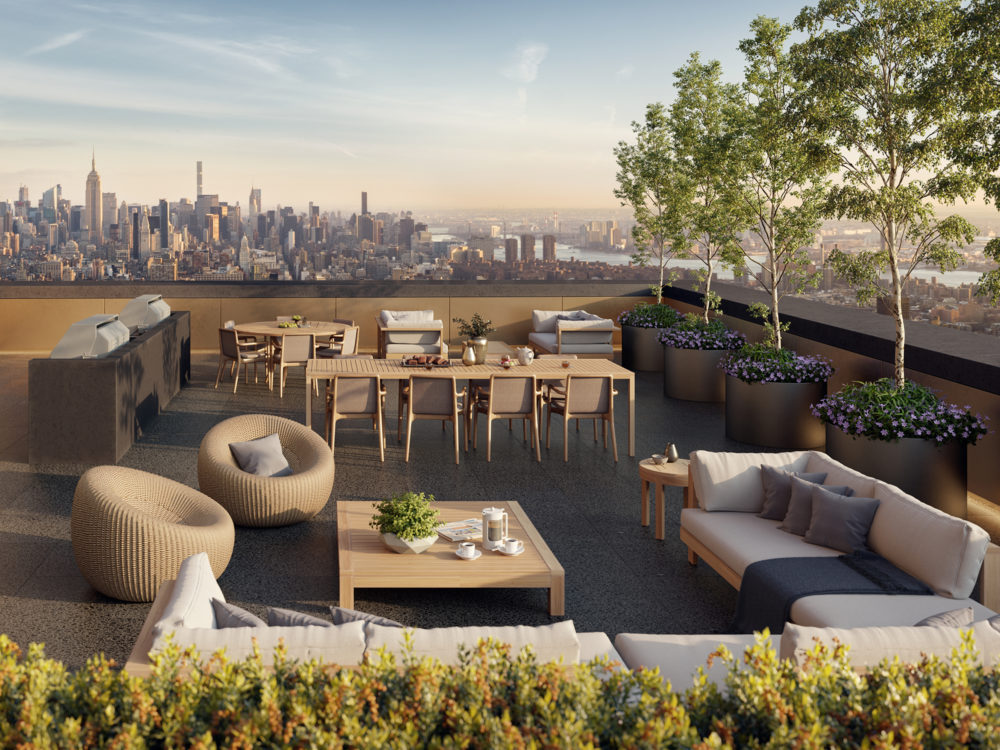 Exterior view of 130 William condominiums rooftop with view of New York City. Has a dining table and couches to sit.