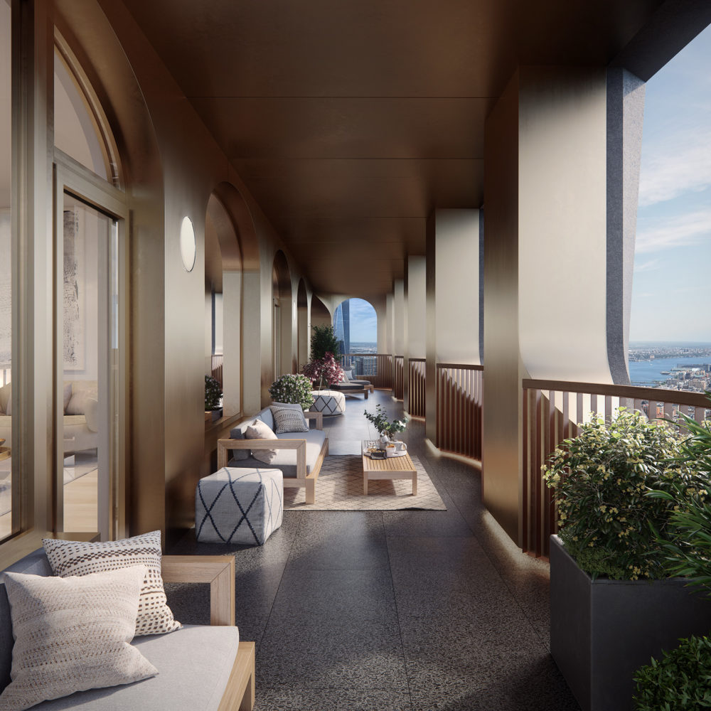 View of corner loggia balcony at 130 William condominiums in New York City. Includes furniture to sit and a view of NYC.