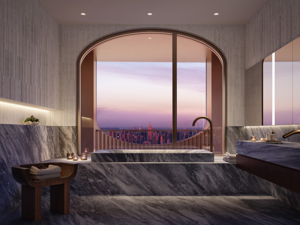 Interior view of 130 William residential master bathroom in New York City. Includes an arched window and marble bathtub.