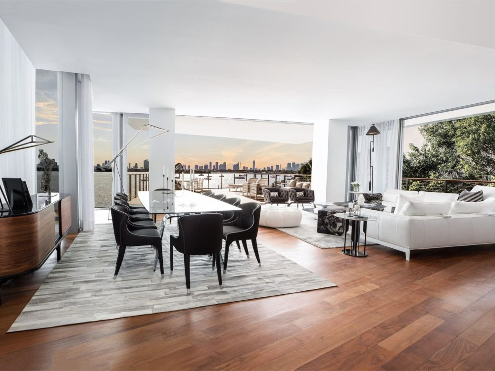 Living space at Monad Terrace luxury condos in Miami. Open concept living and dining room fully furnished with wood floors.