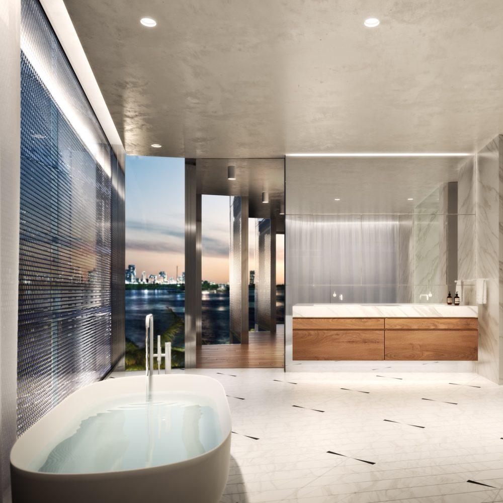 Master bathroom at Monad Terrace luxury condos in Miami. Tile floor, stone walls, soaking tub, shower, and double vanity.