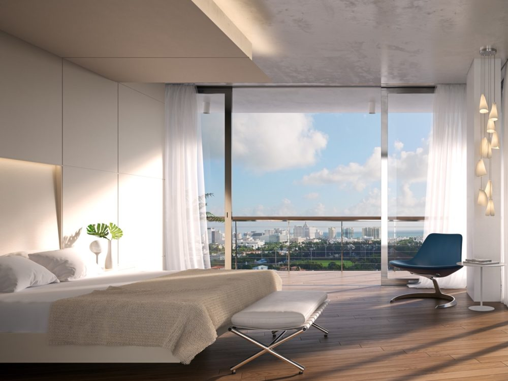 Master bedroom at Monad Terrace in Miami. Corner room with floor-to-ceilings windows, bedroom furniture and bay views.
