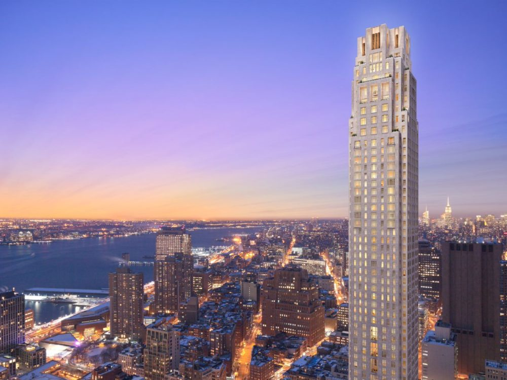 Exterior aerial view of 30 Park Place with view of New York City at night. Includes detailed architecture of building.