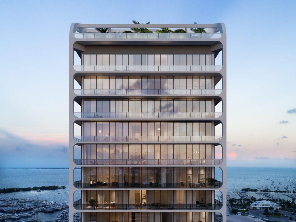 Upper floors of Mr. C Residences condominium complex in Miami. Top floors of building with glass walls overlooking marina.