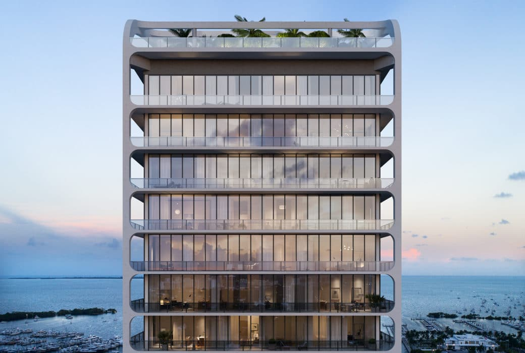 Upper floors of Mr. C Residences condominium complex in Miami. Top floors of building with glass walls overlooking marina.