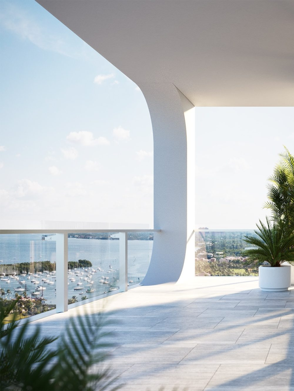 Terrace and living room at Mr. C Residences in Miami. Floor-to-ceiling windows with access to balcony from the living room.