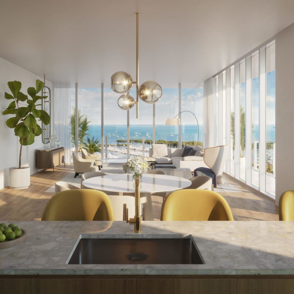 Condo interior at Mr. C Residences in Miami. White walls and open concept with dining table and floor-to-ceiling windows.