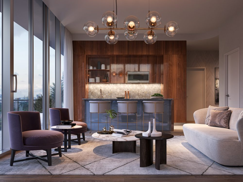 Condo interior at Mr. C Residences in Miami. Open concept living room and kitchen, with furniture, chairs, & kitchen island.