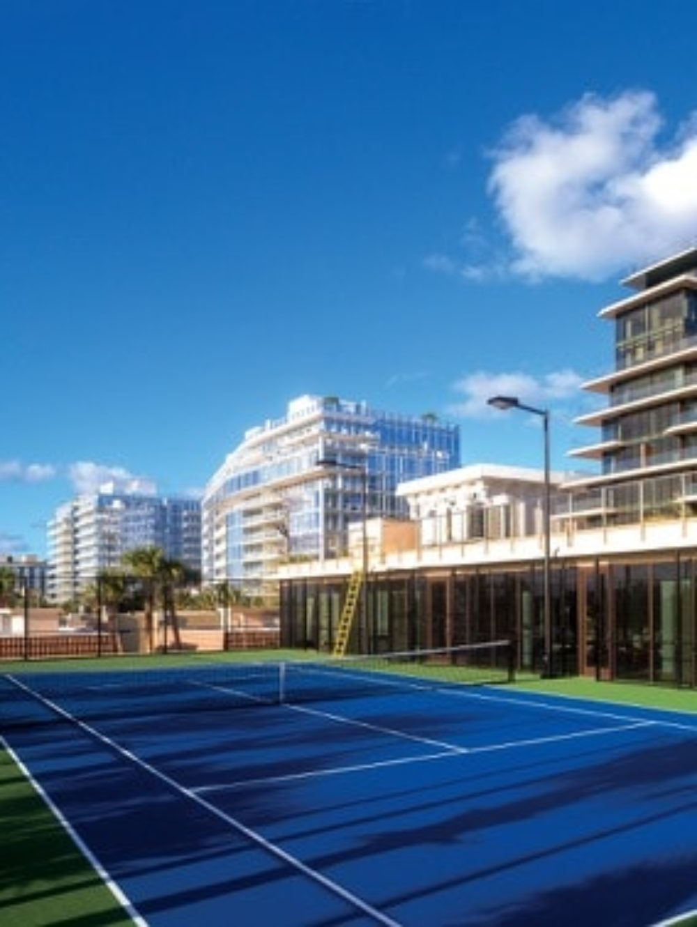 Exterior view of Arte Surfside condominiums tennis court. Has a view of oceanfront and surrounding buildings.