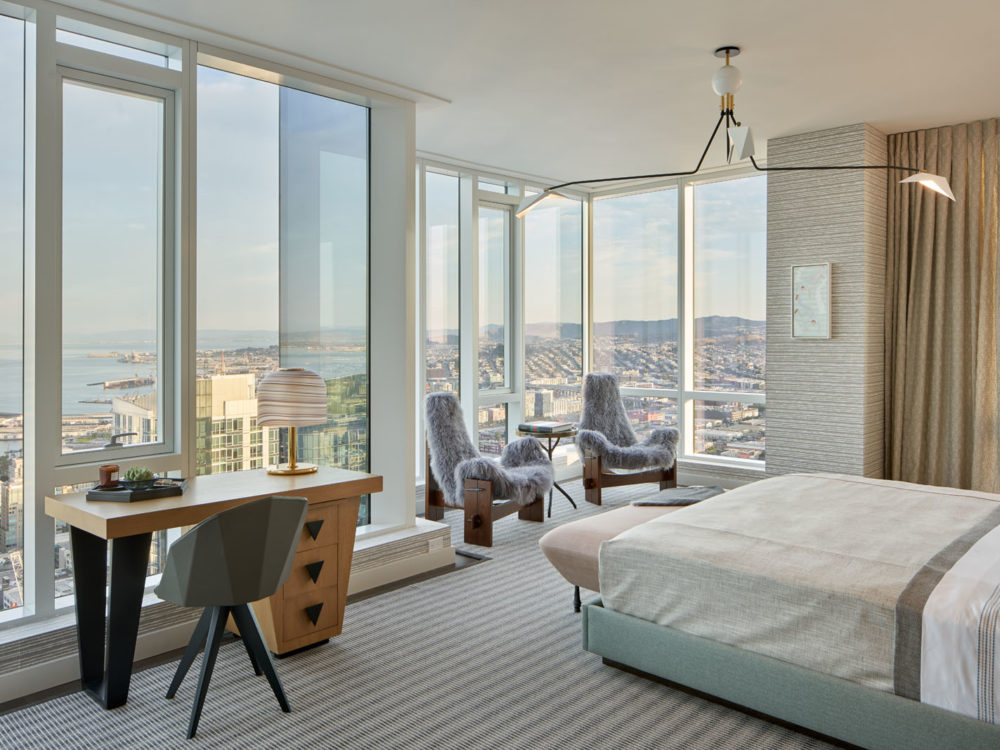 Penthouse master bedroom at The Avery condos in San Francisco. Floor-to-ceiling windows for natural light and city views.