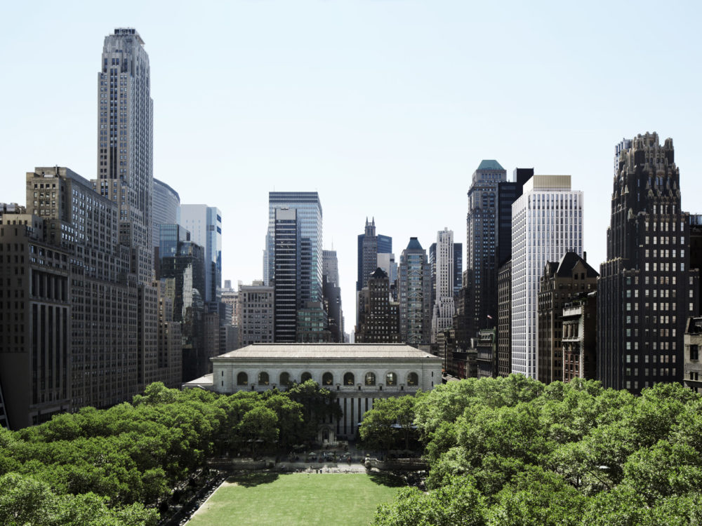 View of Bryant Park and surrounding buildings in downtown Manhattan. Exterior of The Bryant condos can be seen to the east.
