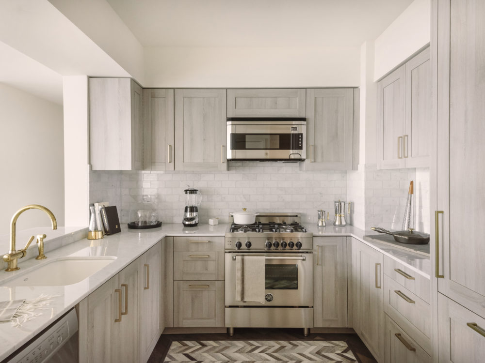 Interior view of residential kitchen inside 181 Fremont in San Francisco. Includes white walls and full amenities.