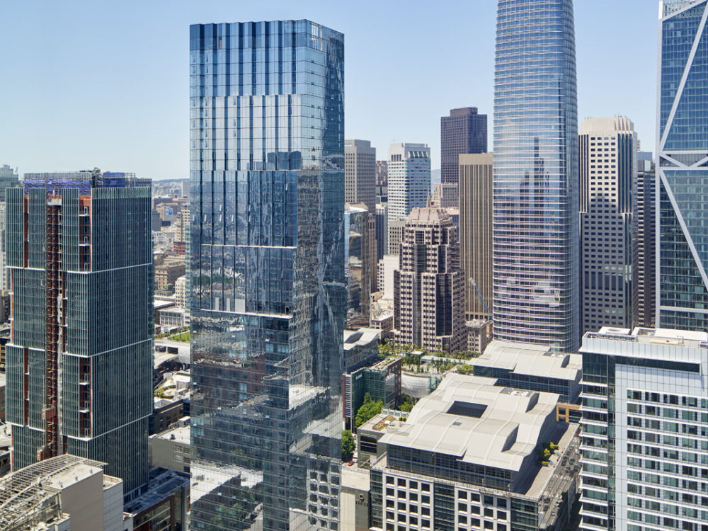 Birdseye view of high rises and city skyline in the Bay area with The Avery condominiums left center of the picture.