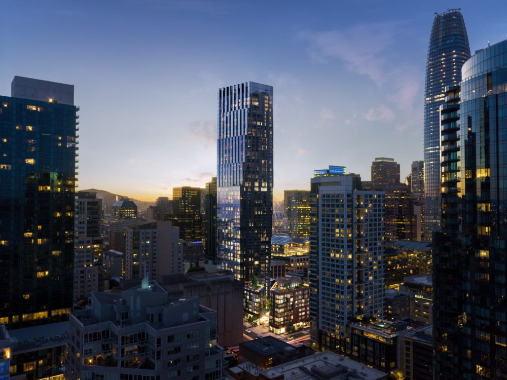 Aerial view of the Bay Area city skyline during sunset with The Avery luxury condominiums in the center of the photo.