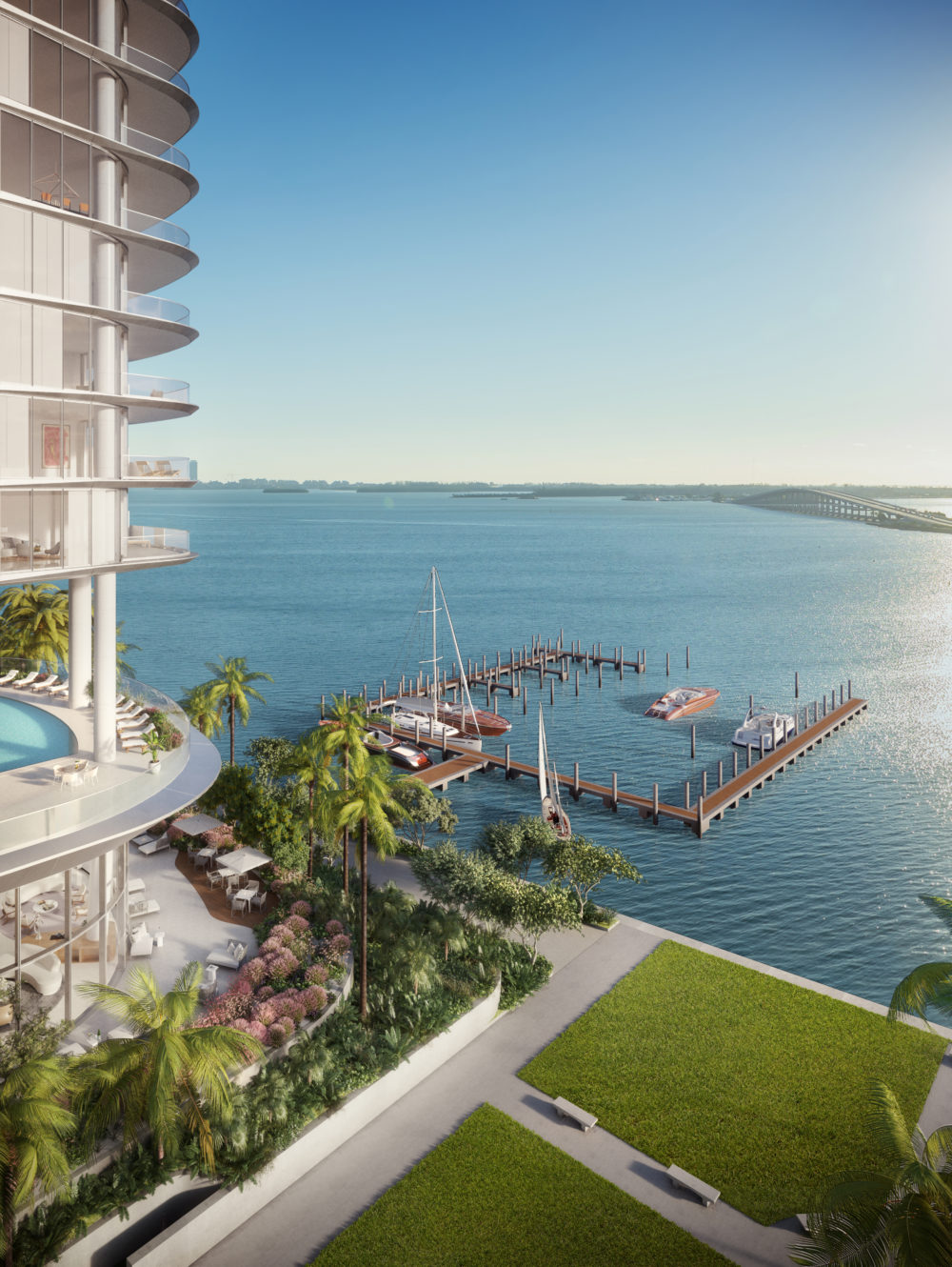 Birdseye exterior view of Una Residences luxury condominiums second floor pool and the marina in Miami's Biscayne Bay.