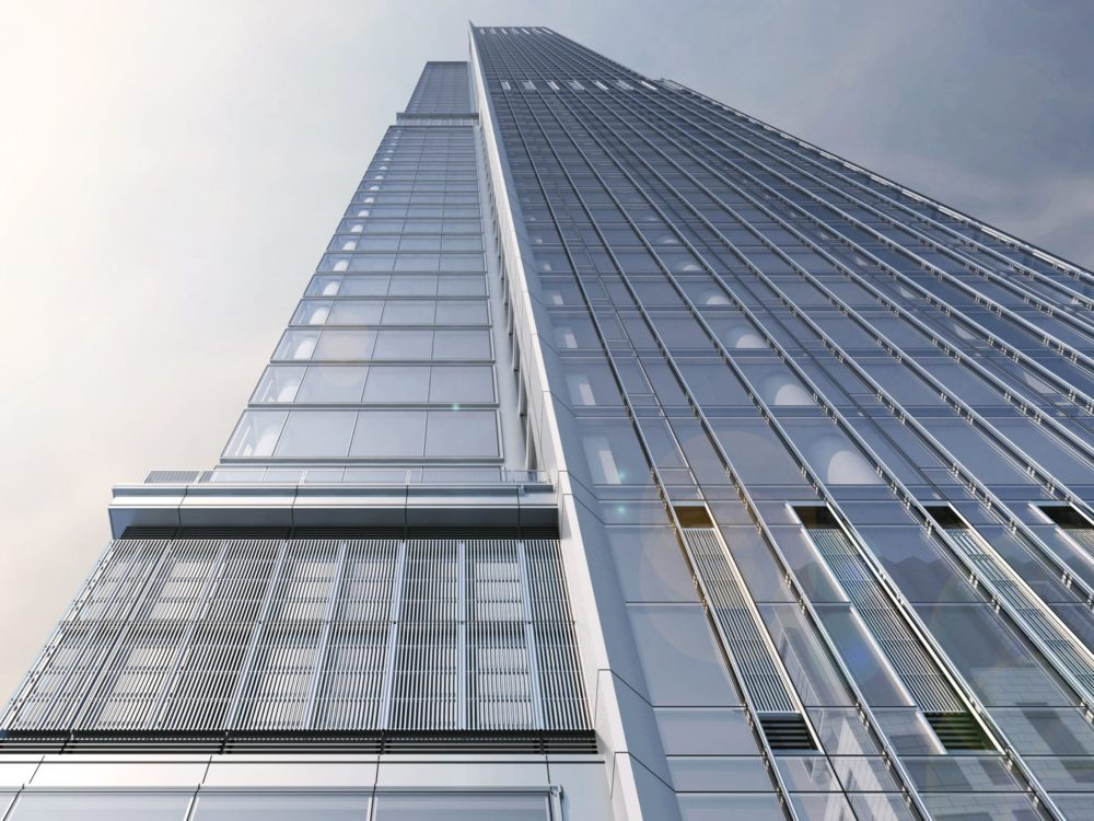 Exterior scale view of Central Park Tower condominiums in New York City. Has glass paneling with cloudy skies.
