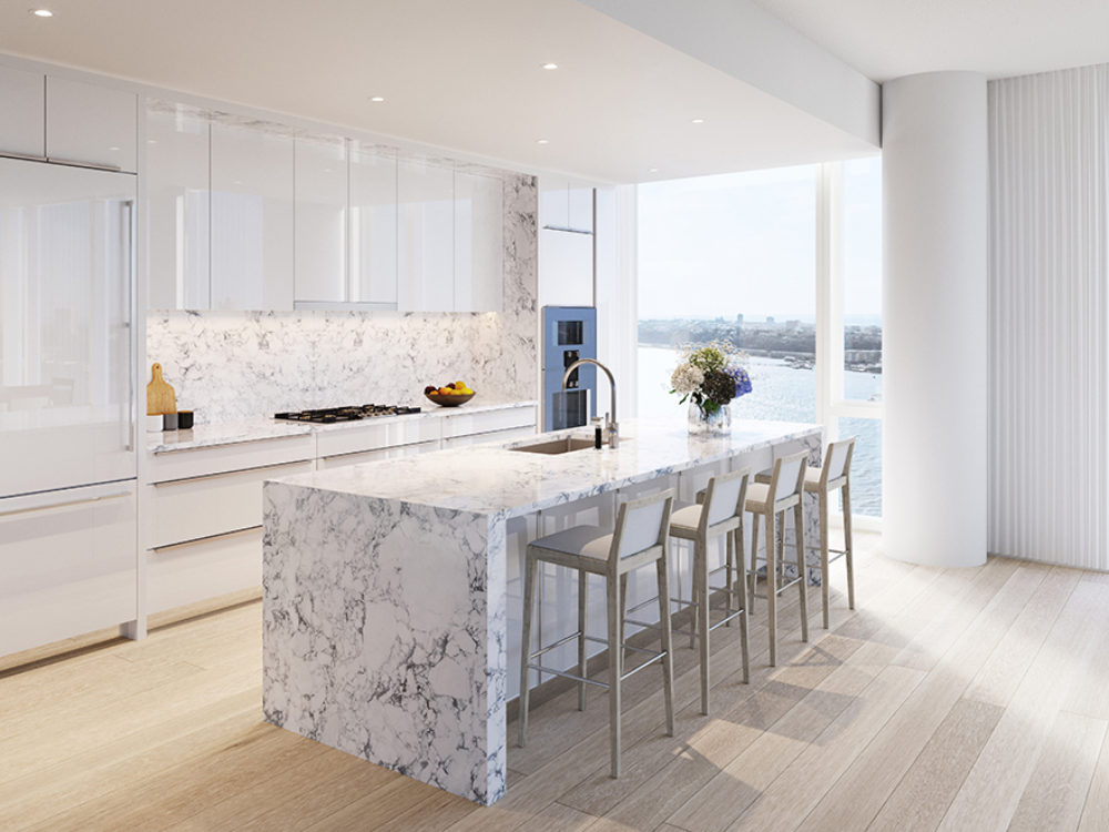 Waterline Square Condo kitchen in NYC with hardwood floors, stone countertops, white cabinets and floor-to-ceiling windows.