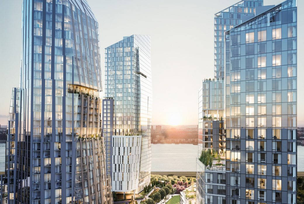 View of Waterline Square luxury residences in NYC. Three towers split by a walkway with raised planters on the Hudson River.