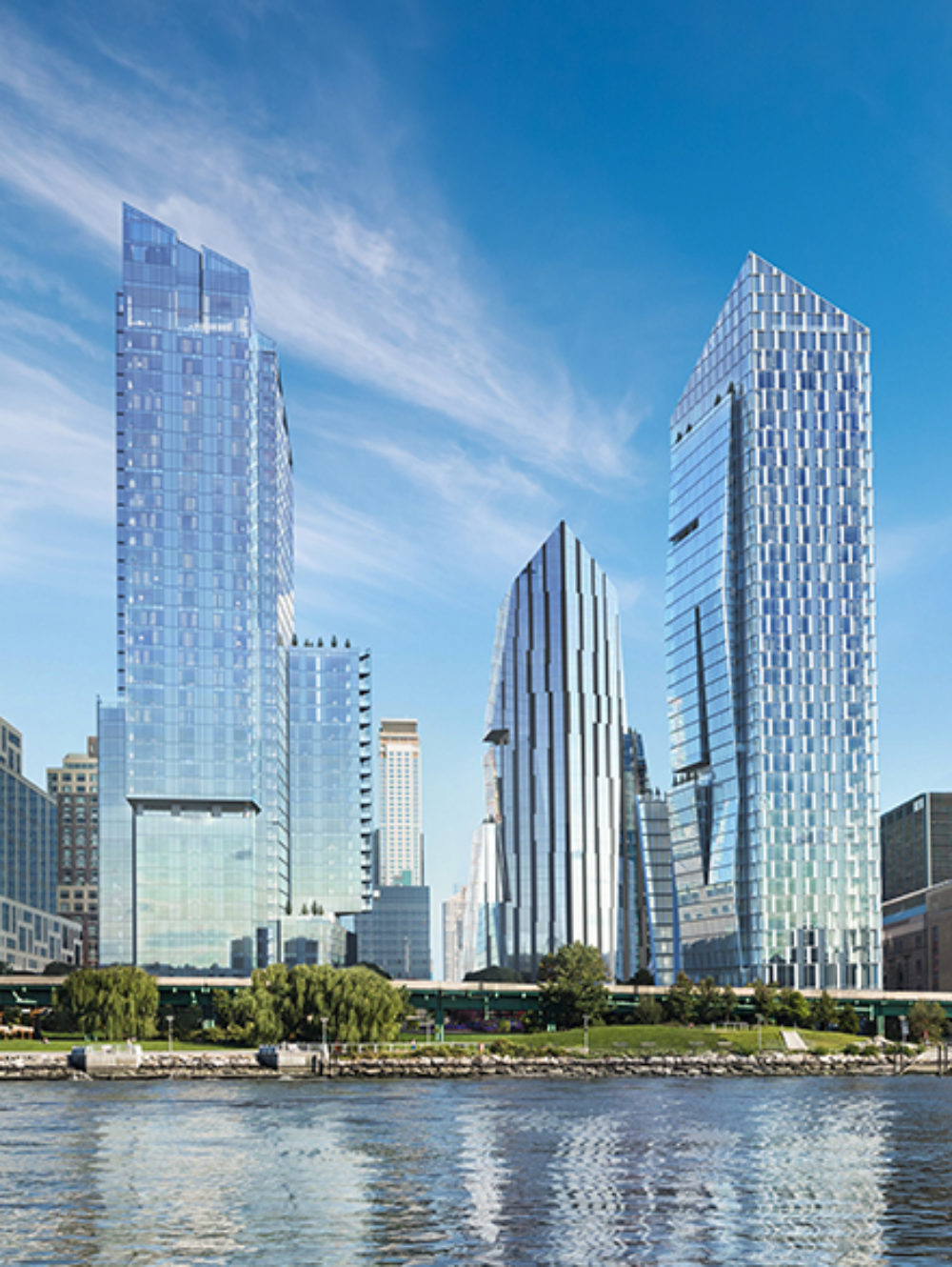 View of Waterline Square Condominiums from the Hudson River in New York City. Riverfront park runs below the towers.