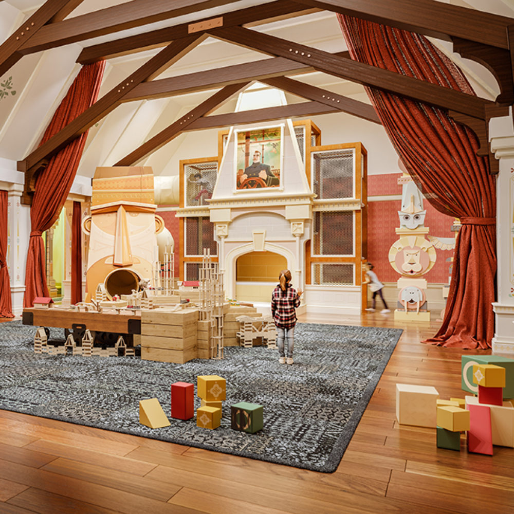 Children's playroom at Waterline Square in NYC. Large room with high ceilings, red and white walls, red drapes, and toys.
