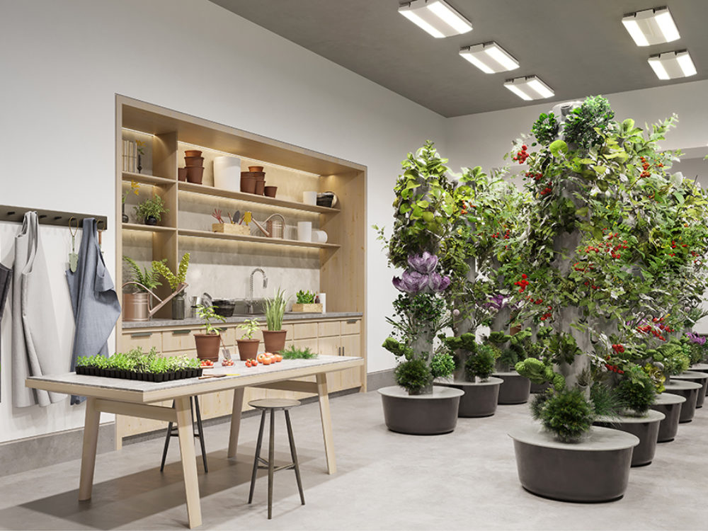 The gardening studio at the Waterline Square residences in NYC. White walls, built-in shelves, potted plants and work table.