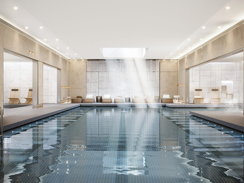 Large indoor pool at the Waterline Square condos in New York. Stone walls,