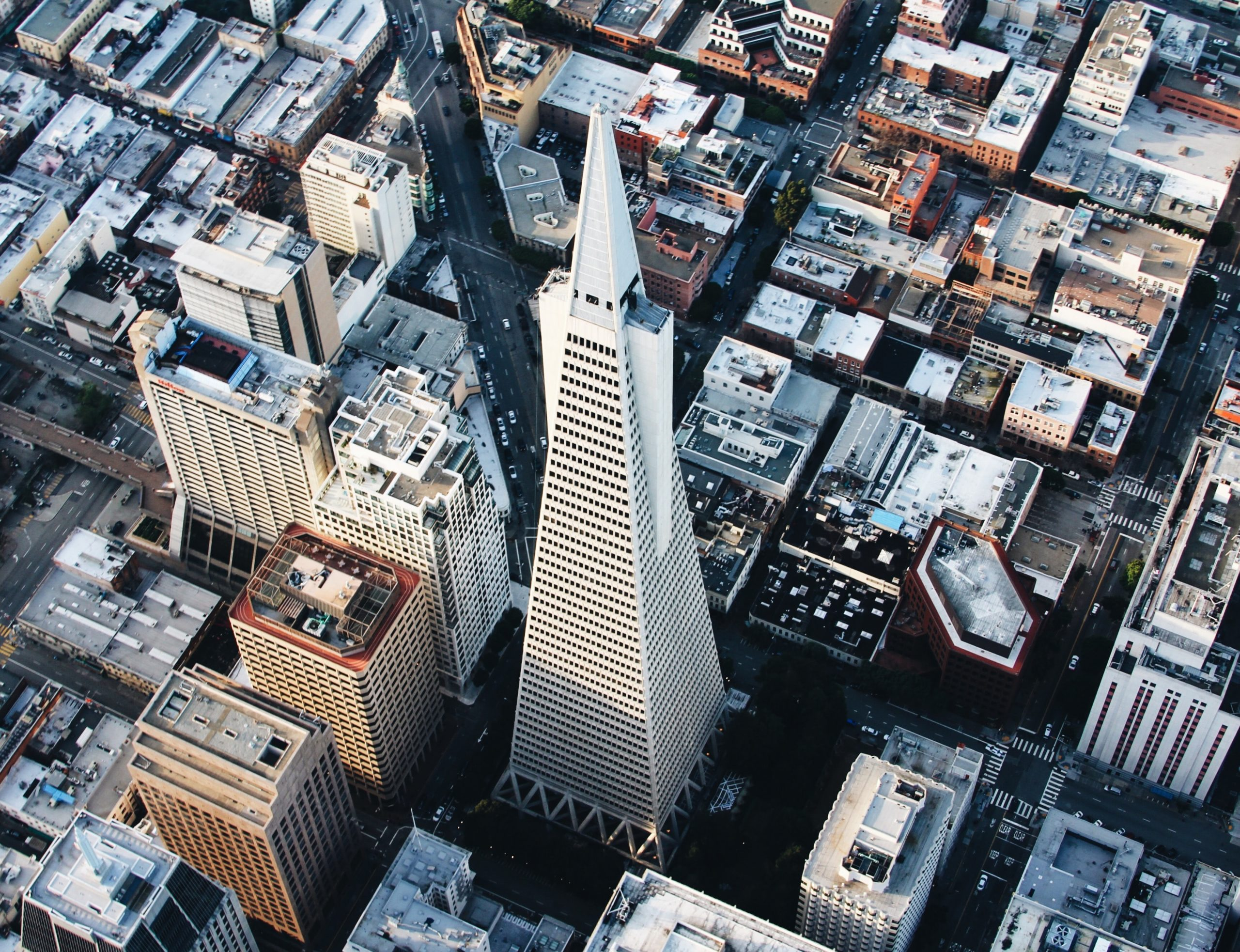 Aerial view of the Transamerica Pyramid skyscraper in San Francisco's financial district. White pointy tower in downtown.