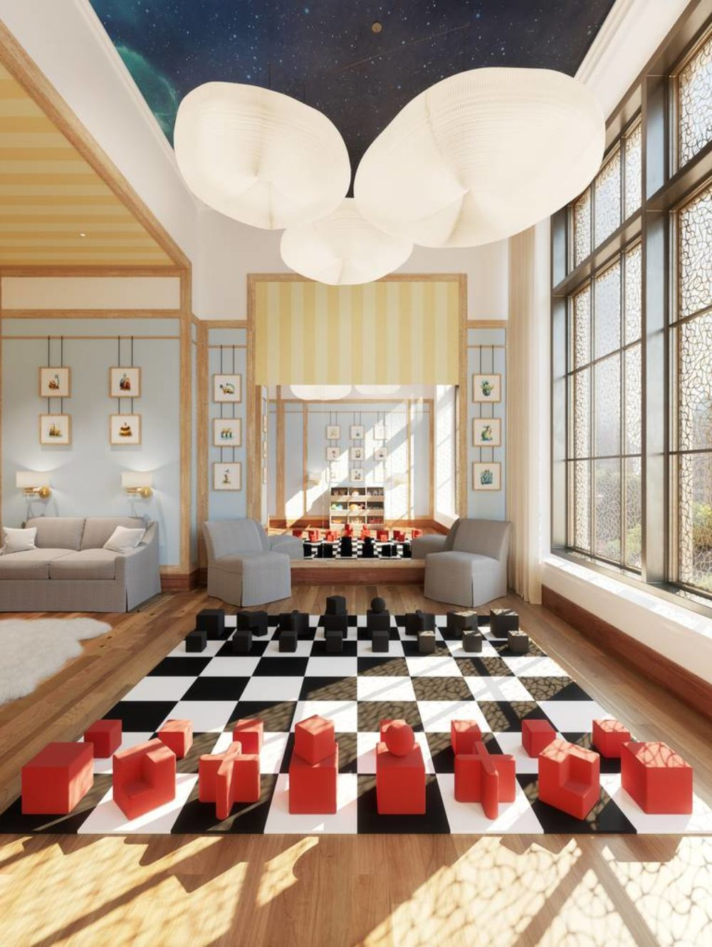 Interior view of kids room inside 25 Park Row condominiums with window view of NYC and giant sized chess board in the center.