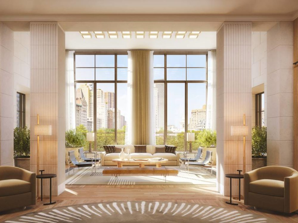 Interior view of reading room inside 25 Park Row condominiums. Includes chairs, window view of NYC, and wood bookcase.