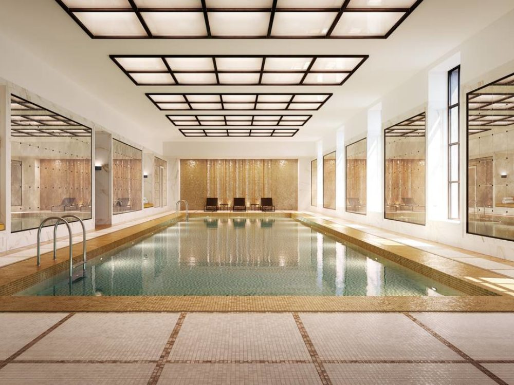 Interior view of 25 Park Row residence indoor swimming pool. Includes a light fixture and tile flooring located in NYC.