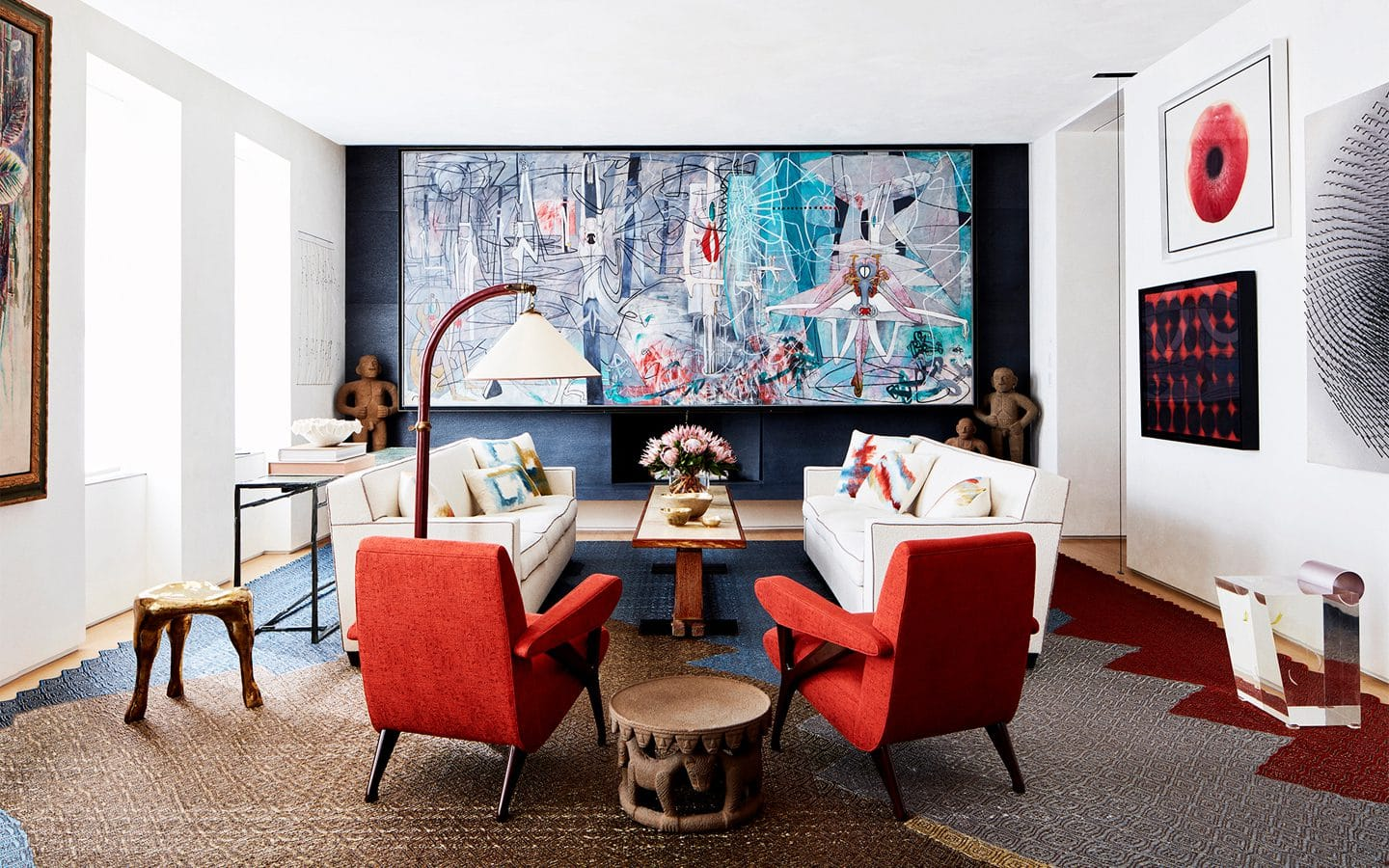 Living room with red couch and large abstract painting designed by Amy Lau for Park Avenue Triplex.