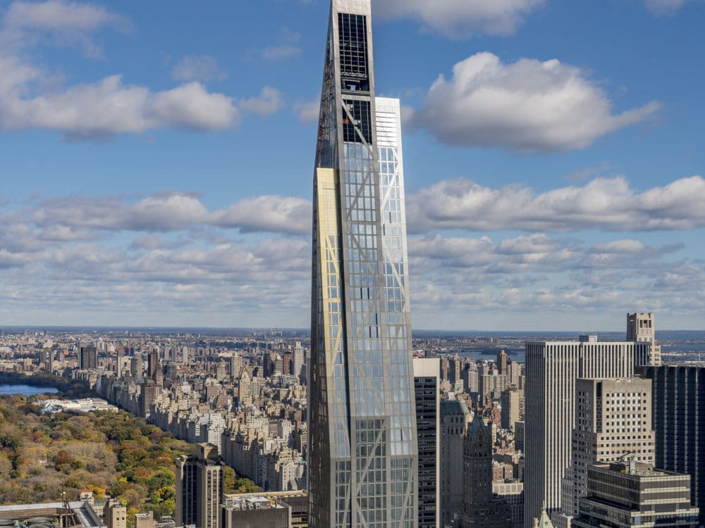 Exterior aerial view of 53 West 53 condominiums with view of New York City and central park.