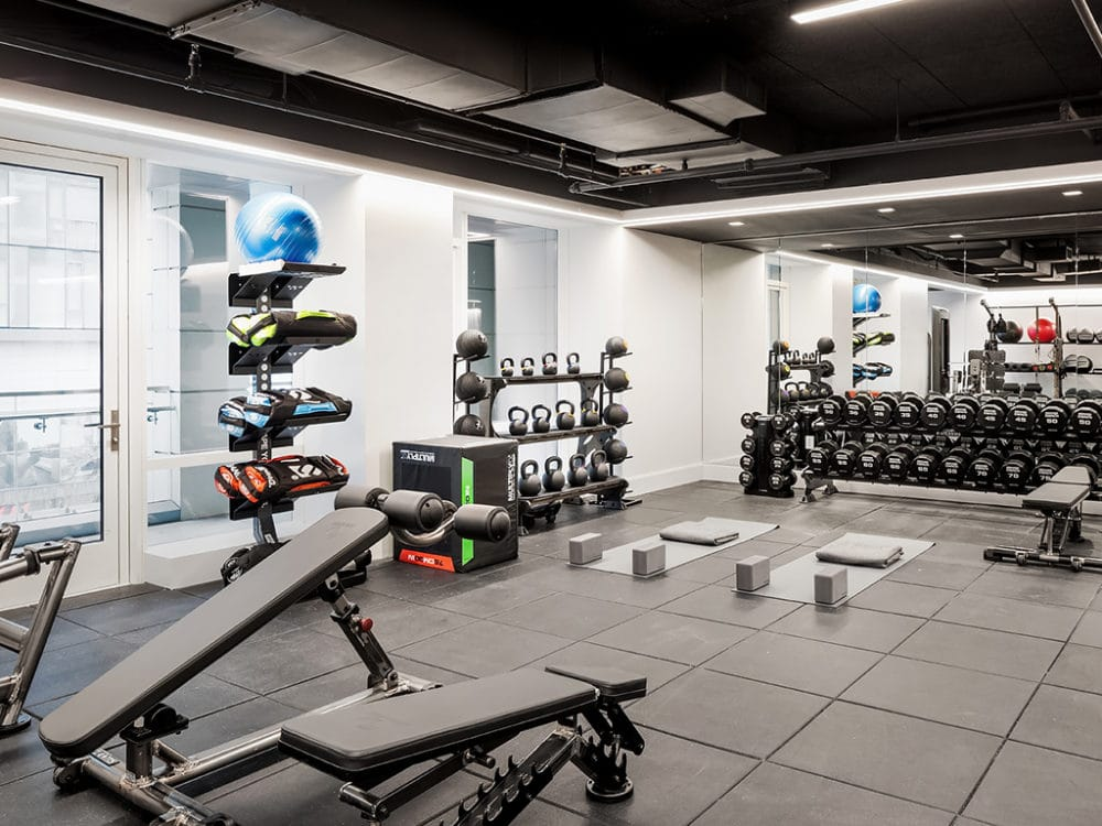 Fitness center at The Hayworth condominiums in New York. Workout room with free weights, benches and yoga balls on a rack.