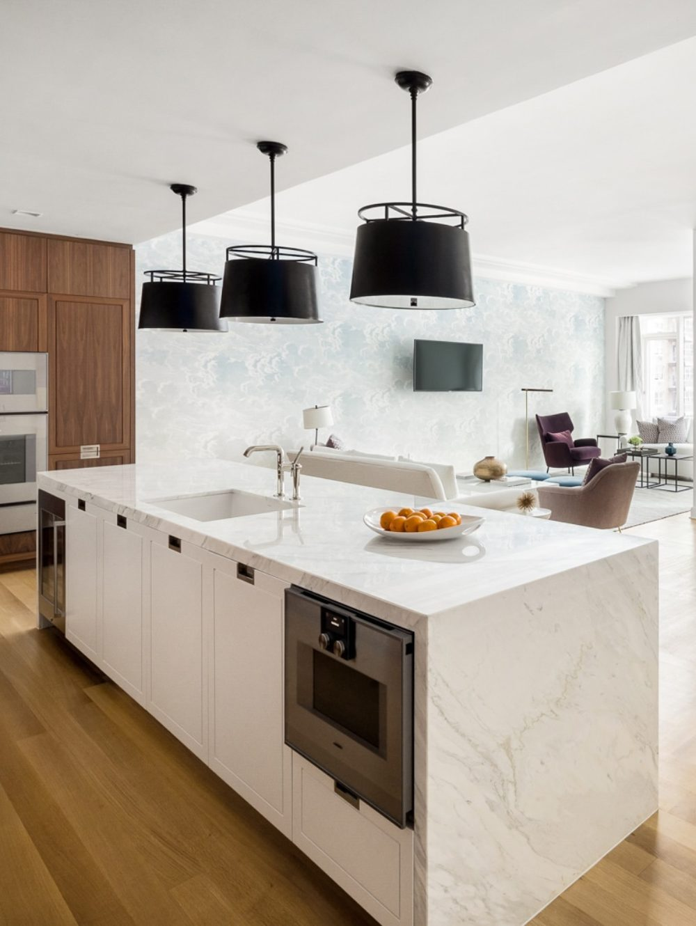 Kitchen and dinner room at The Hayworth condos in NYC. Open concept living with kitchen, dining room and living room.