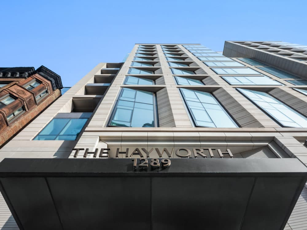 Exterior view of The Hayworth condo in New York. Street view looking straight up the side of the building on a sunny day.