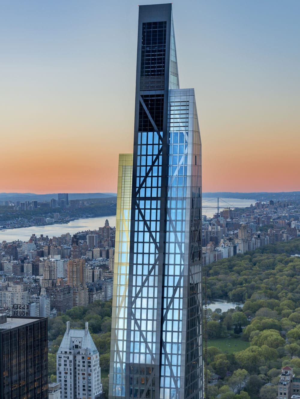 Exterior aerial view of 53 West 53 condominiums with view of New York City, the river front and central park.