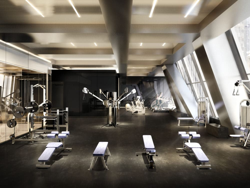 53 West 53 residence indoor fitness center with window view of New York City. Has cardio and weightlifting equipment.