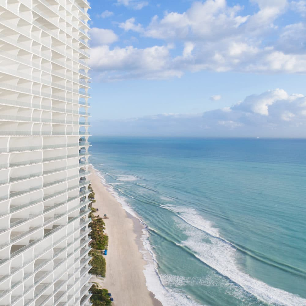 Exterior architecture of Jade Signature condominiums with oceanfront view in Sunny Isles.