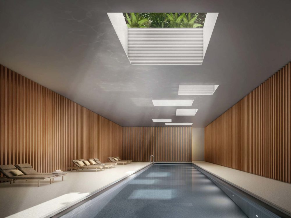 A pool surrounded by terrazzo floors and reclaimed pine walls that opens up to gardens with skylights at Jardim in NYC.