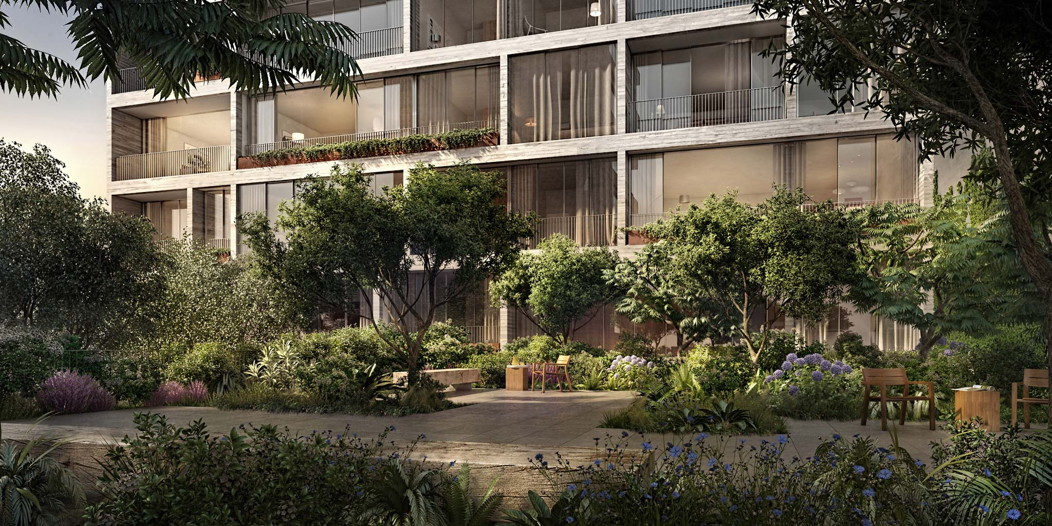 Second level garden at Jardim Condominium in New York City. Open patio with tables, seats and a bench surrounded by greenery.