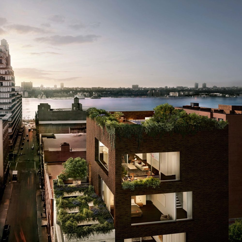 Aerial view of penthouse at Jardim in NYC. Side of penthouse with view inside the penthouse and city skyline in the distance.
