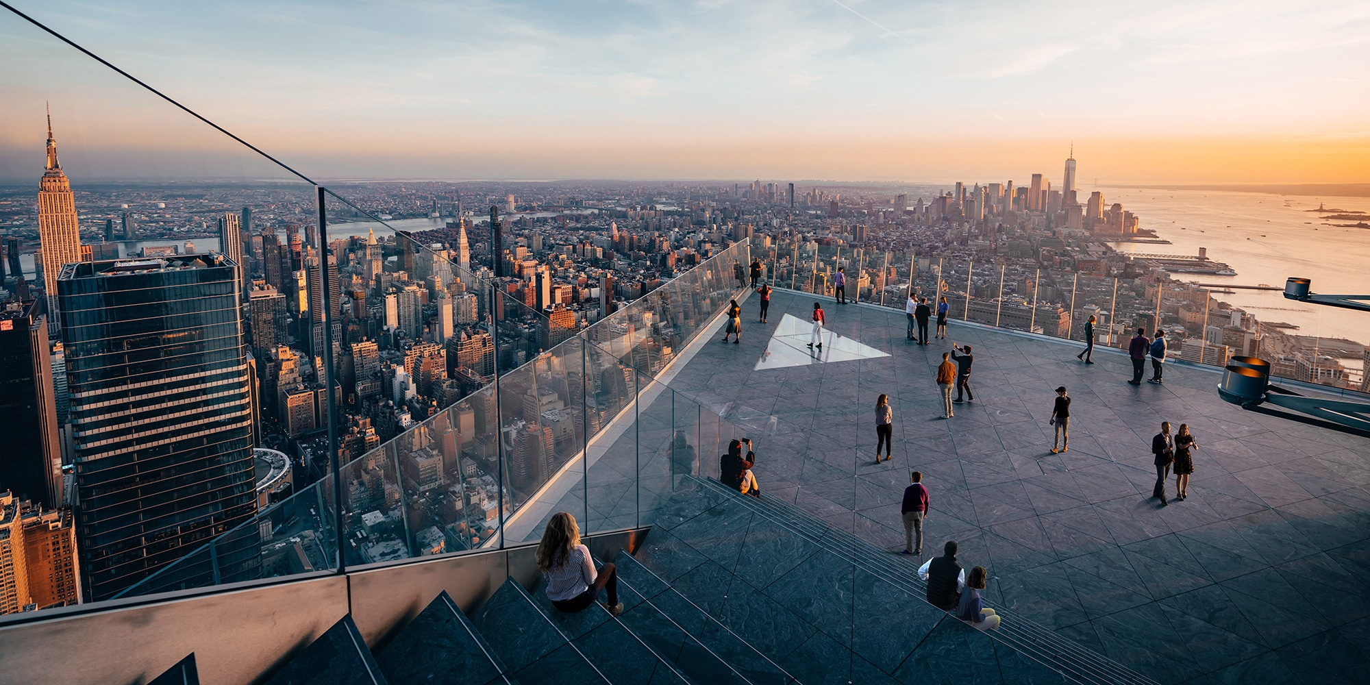 View from Edge observation deck at 30 Hudson Yards in New York. Overlooking Brooklyn and the Hudson River at sunrise.