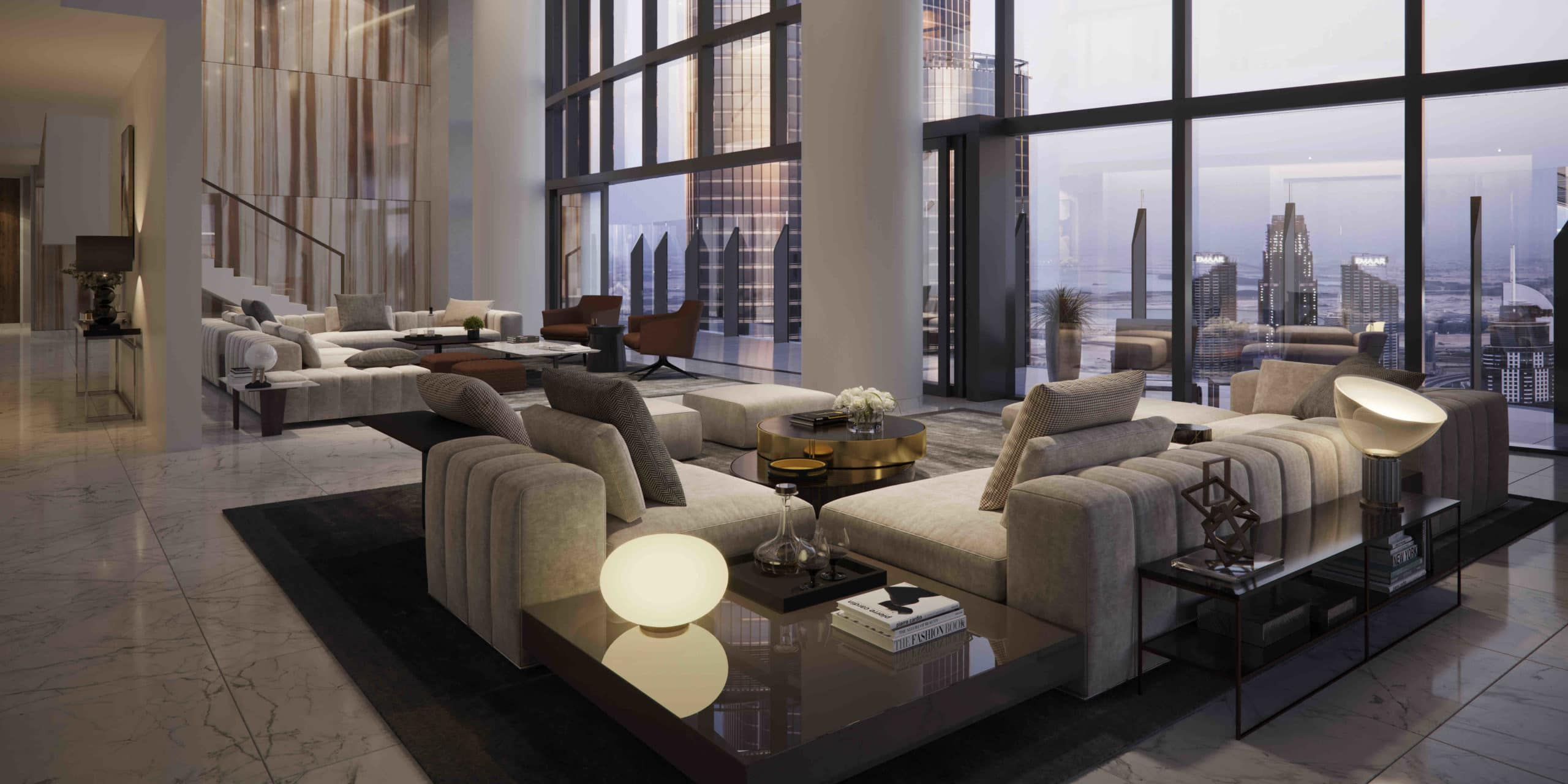 Living room at Il Primo luxury condominiums in Dubai. Large room with pillars, high ceilings, and floor-to-ceiling windows.
