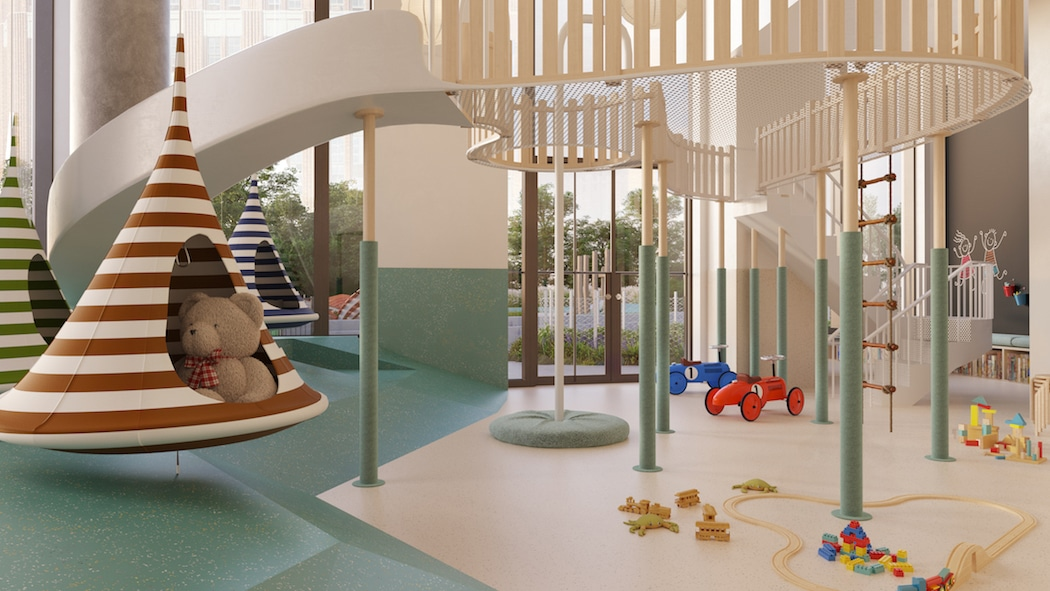 Playroom at 11 Hoyt condos in NYC. Hanging chairs, toys, large play set with slide, carpet and floor-to-ceiling windows.