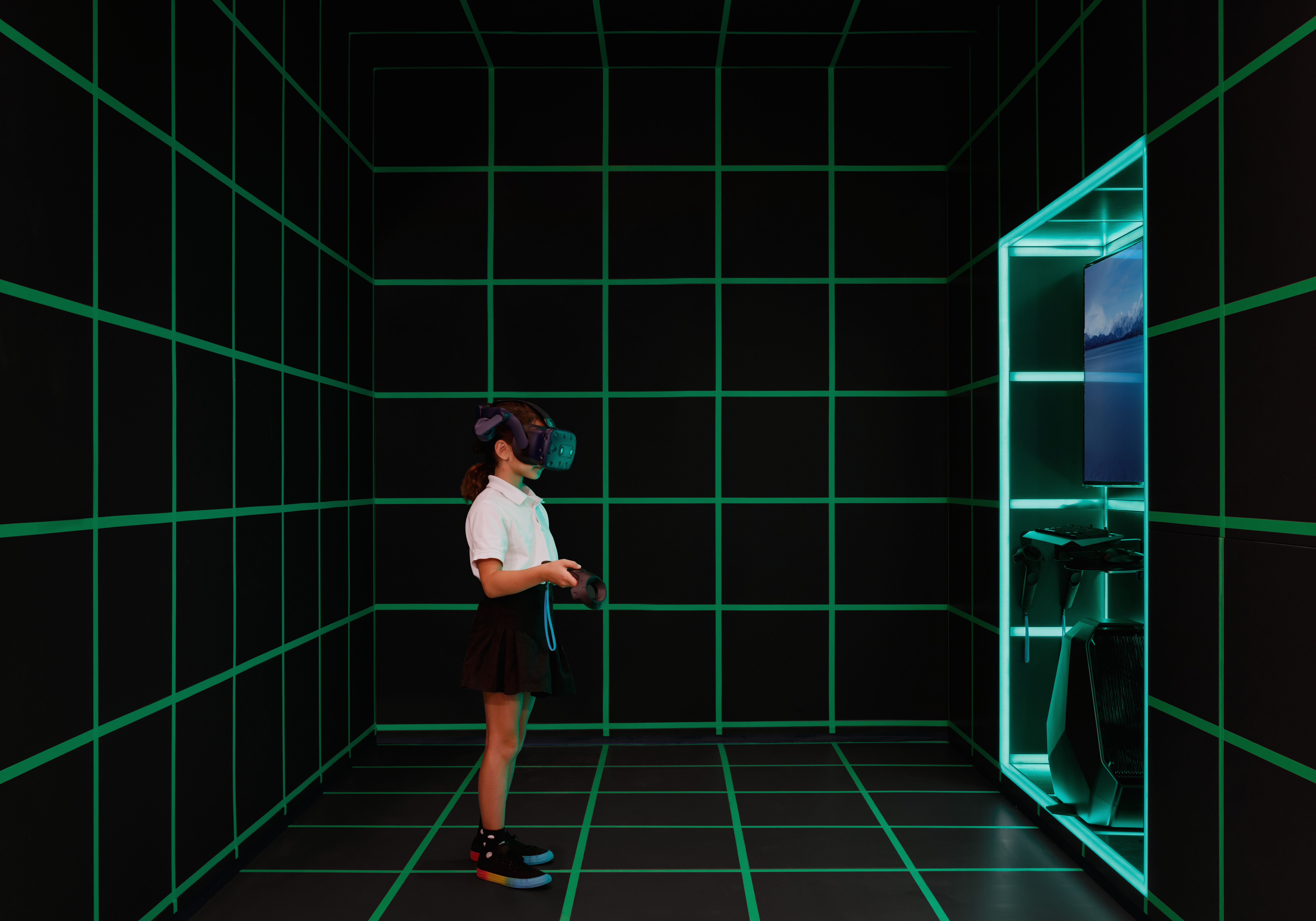 Girl with VR headset and controller in Sandbox creative space at 520 W 28th luxury condominiums in New York City.
