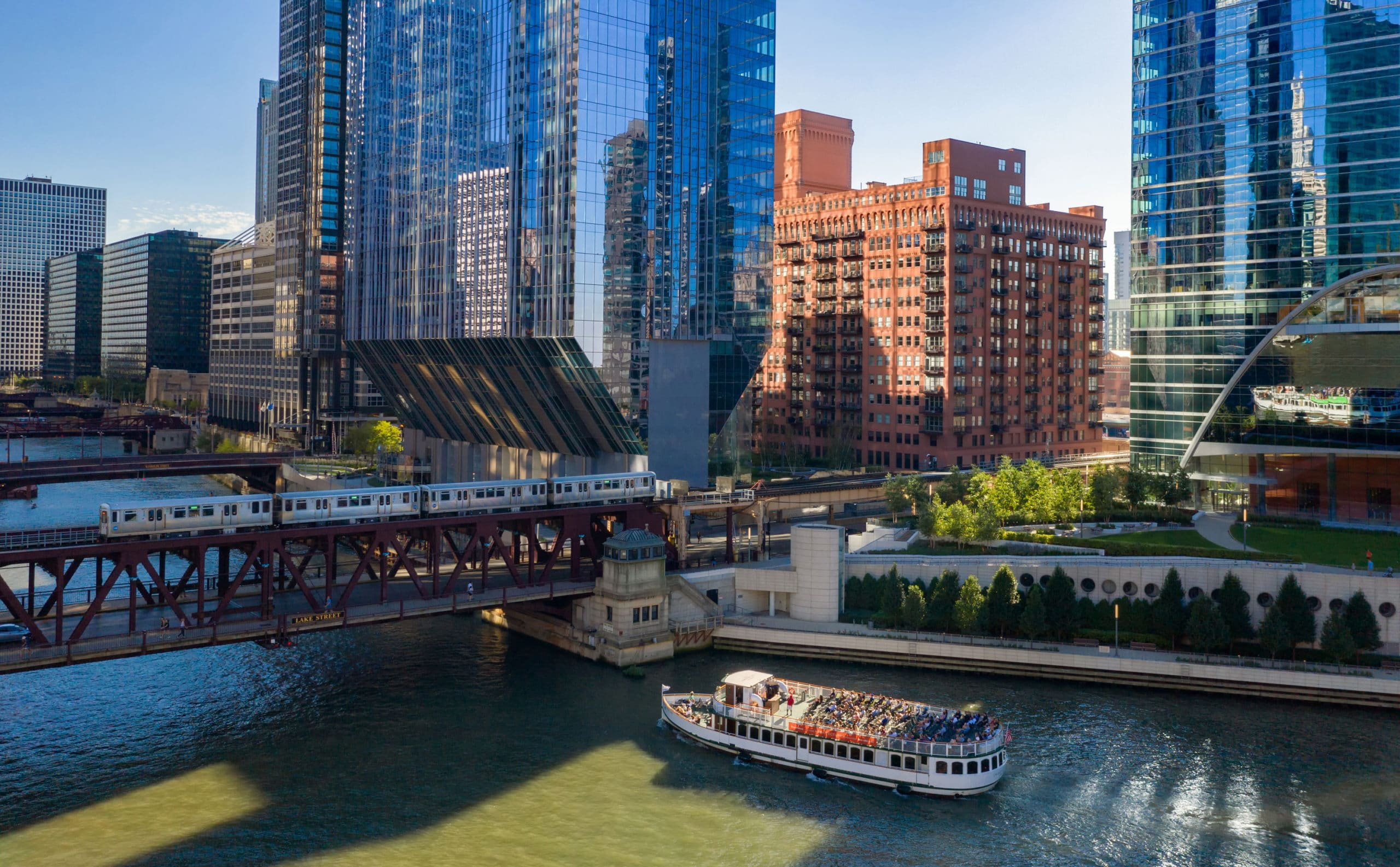 Exterior view of Chicago river with a bridge overpass into the city.