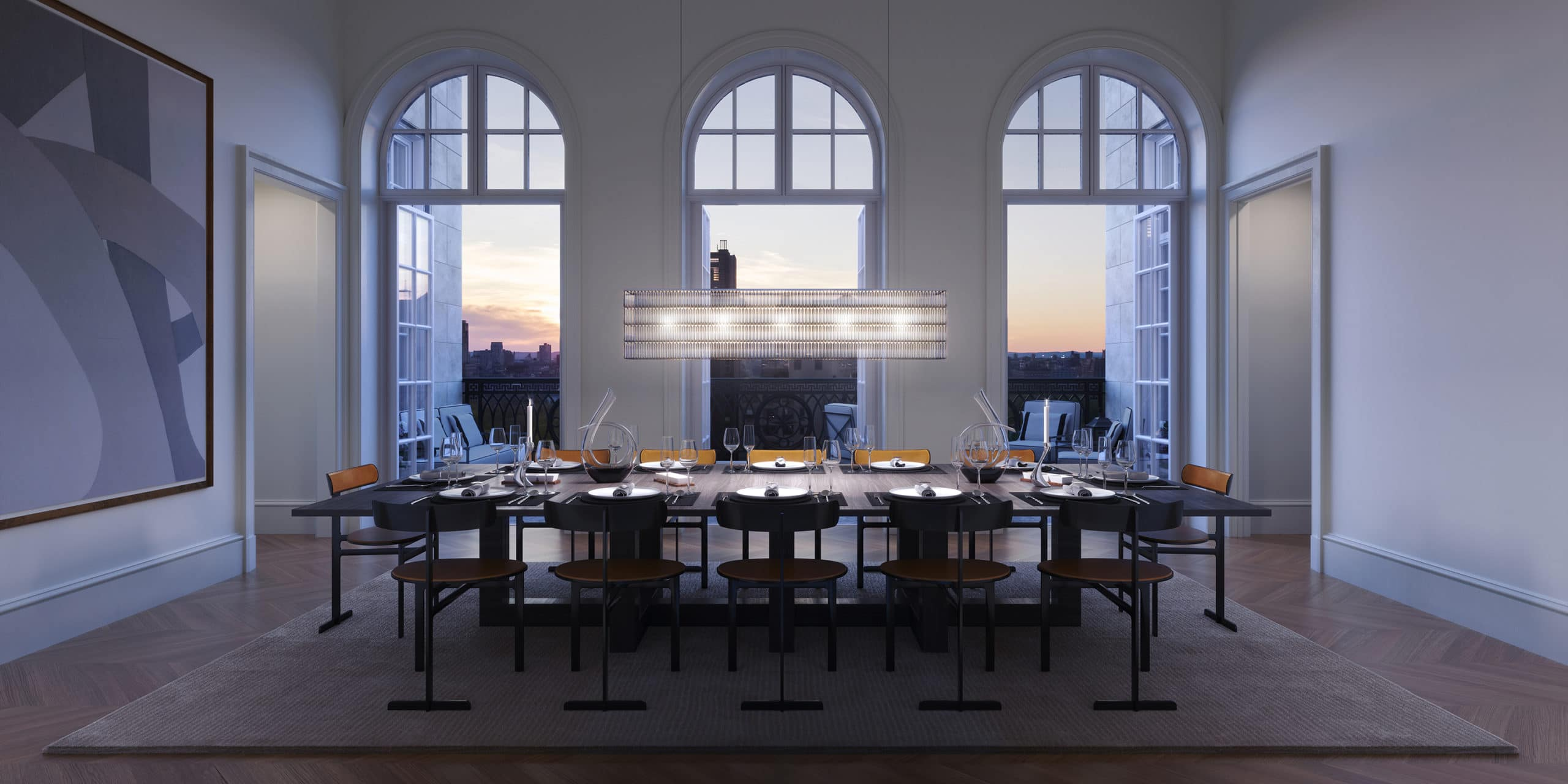 Dining room at The Benson luxury condos in NYC. Tall, arched windows, dark dining table, white walls and long chandelier.