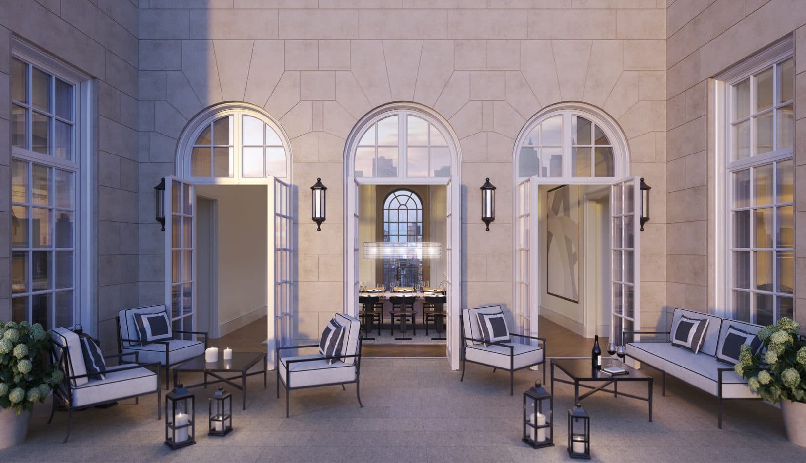 View of penthouse terrace at The Benson condos in New York. Outdoor seating with three doors and two large windows.