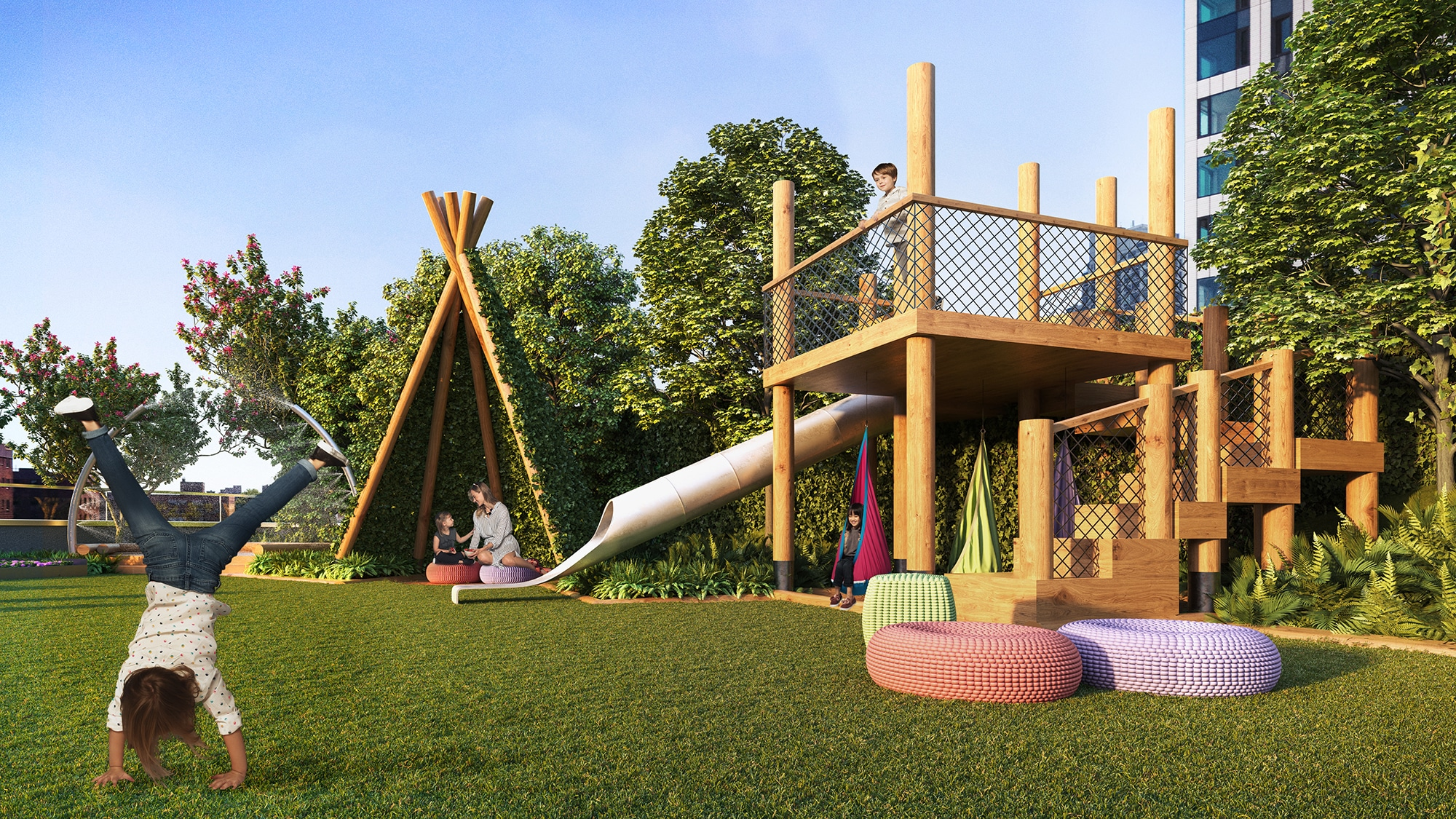 Terrace playroom at Brooklyn Point luxury condos in New York. Large lawn area with wooden play house, slide and teepee.