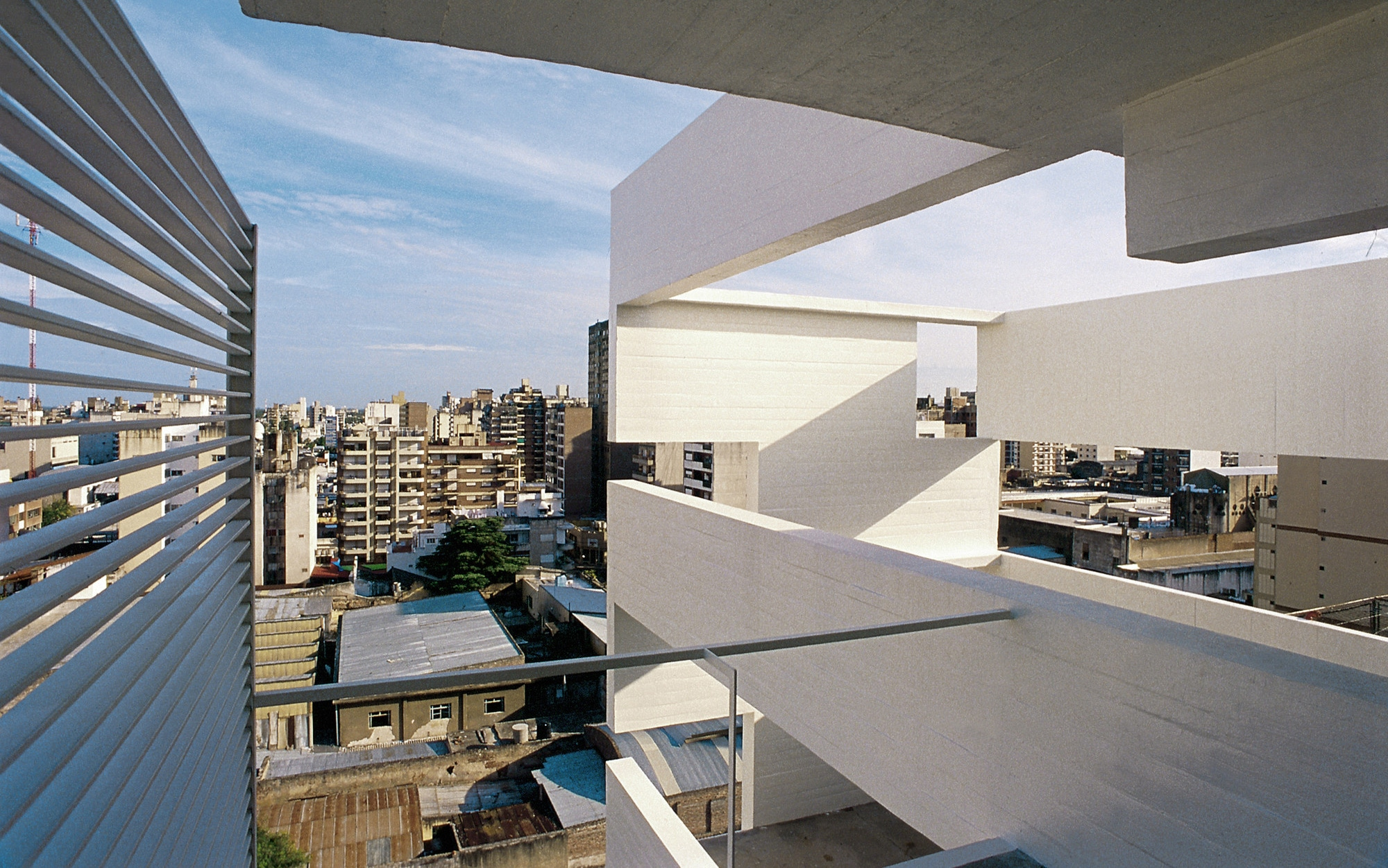 View of Argentina skyline from Altamira building. Has detailed architecture looking at a balcony.